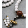 White Naga Shell Bead Mala with Green Howlite Spacers and Vintage Style Tibetan Brass Marker