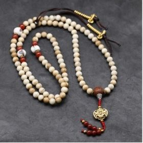 Rustic Naga Shell Bead Mala with Carnelian Spacers Inlaid with a Bodhi Seed Guru Bead