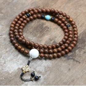 Brown Lotus Seed Mala with Blue Howlite Marker, Matte Onyx Spacers and Naga Shell Guru Bead